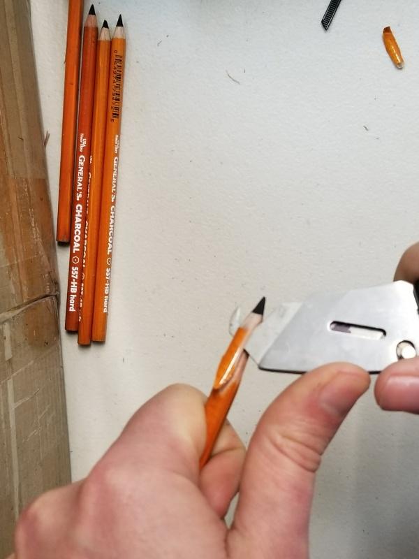 Shaving off a Pencil's Wooden Barrel